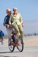 elderly couple on a bike ride