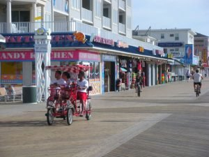 bikes on the boardwalk with candy kitchen in background